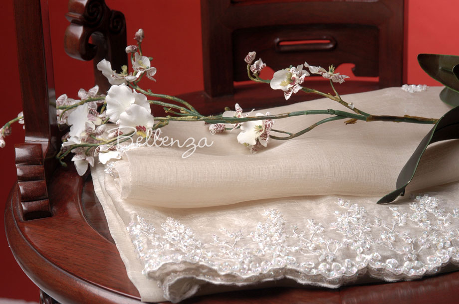 Embroidered shawl using ivory fabric; has beaded clear sequins.