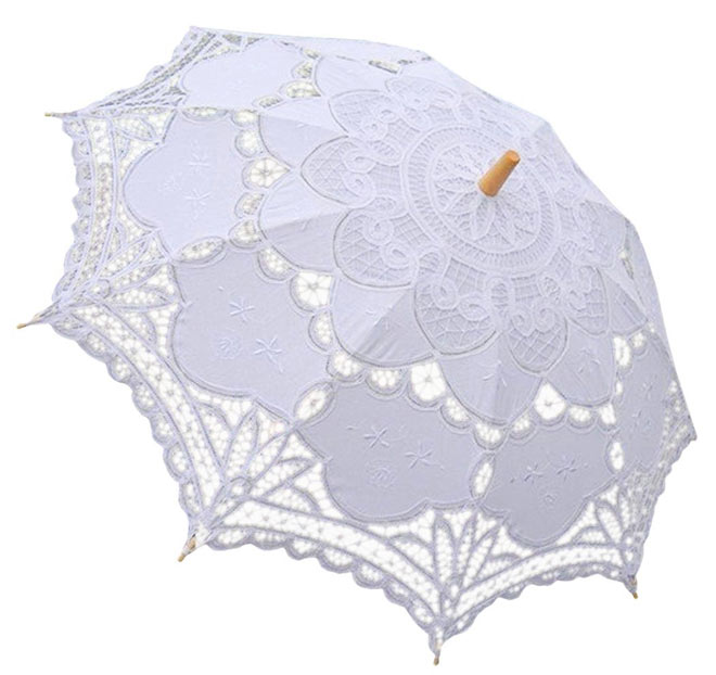 White lace parasols for the bride or bridesmaids at a vintage floral ceremony.