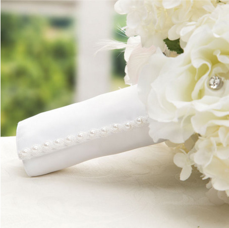 Simply use a white bouquet wrap with pearl trimming to complete the look of this faux bouquet.