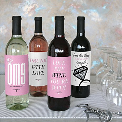 Engagement party wine labels in a palette of pink , white, and black