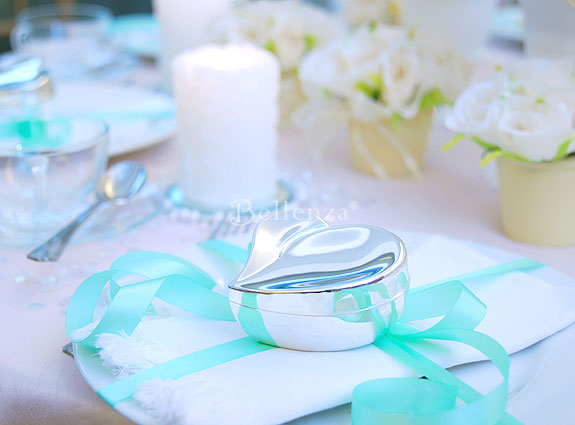 Satin ribbons in Tiffany blue for instance immediately enliven an otherwise pale or neutral table setting while maintaining a cool classy look. & Showcase the Brilliance of Blue for Weddings - Unique Wedding Ideas ...