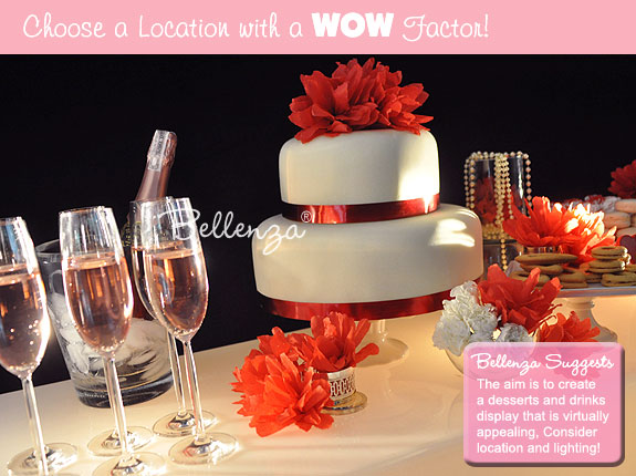 Valentine's bridal shower sweets table with dessert wines and a cake.
