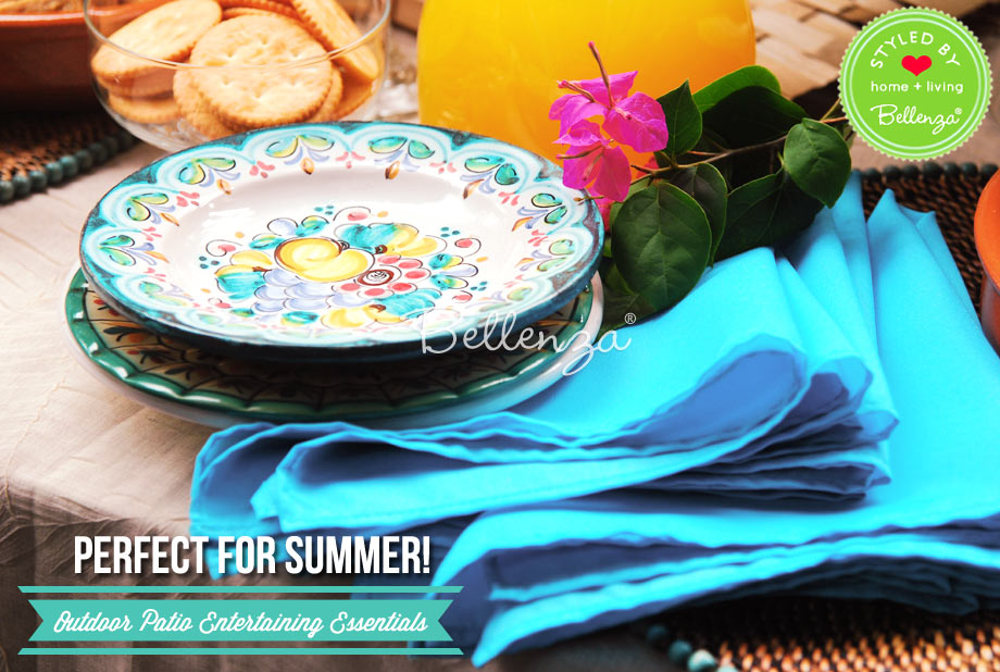 Tropical blue table napkins and serving pieces on table.