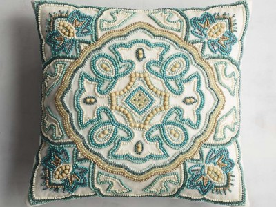 Turquoise Tile Beaded Pillow with a Quatrefoil-inspired Pattern from Pier 1.