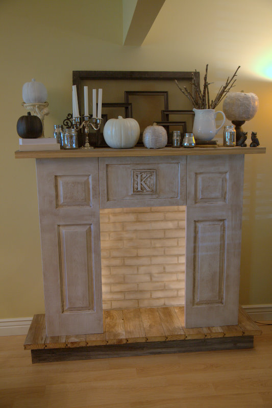 Faux fireplace with reclaimed wood.