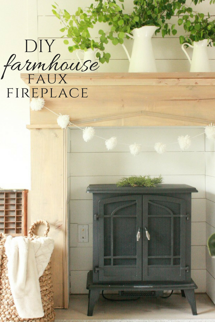 Faux farmhosue style fireplace with hanging garland.