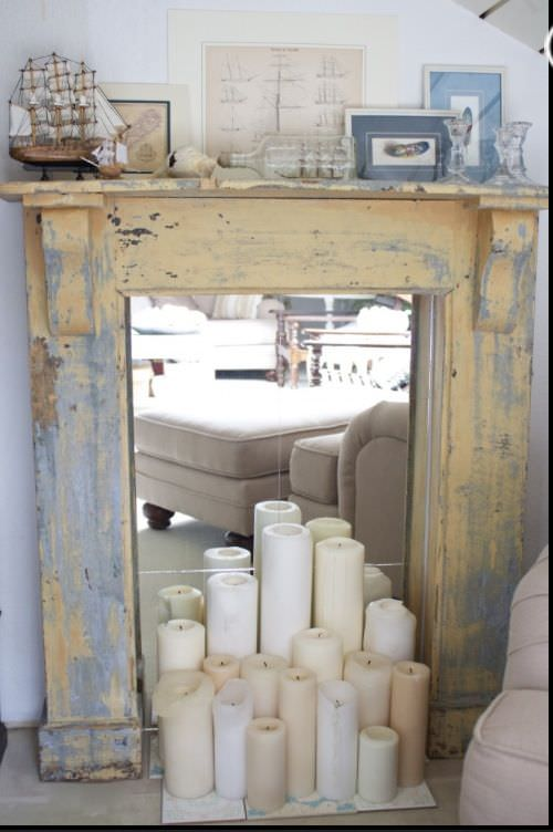 Large pillar candles in a fuax fireplace