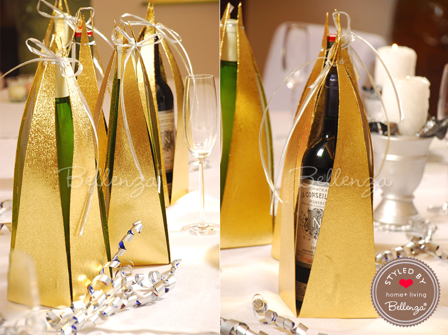 Gold glitter gift wrapped wine bottles