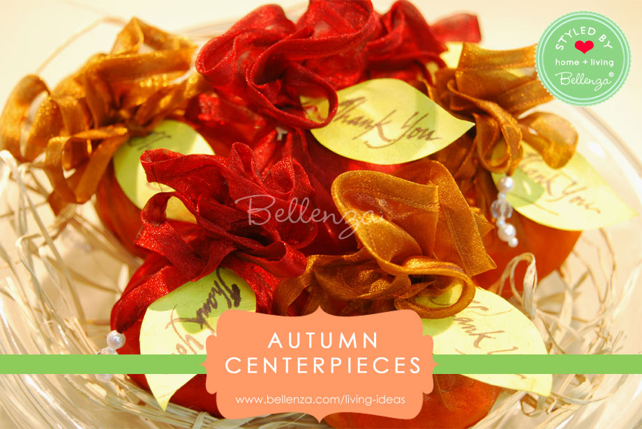 Orange and red wrapped favors centerpieces for fall.