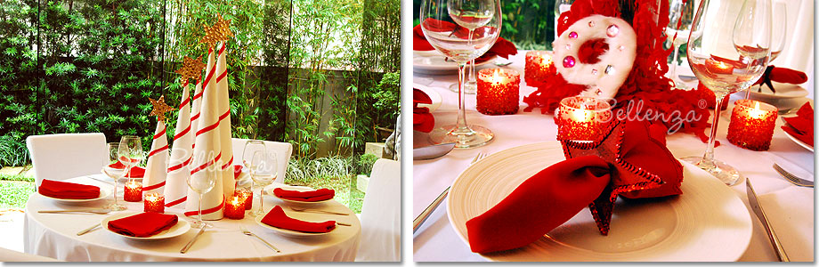 Red and white table settings with red glitter and peppermint cones.