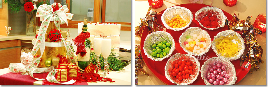 Dessert table display with drinks, cookies, and candies