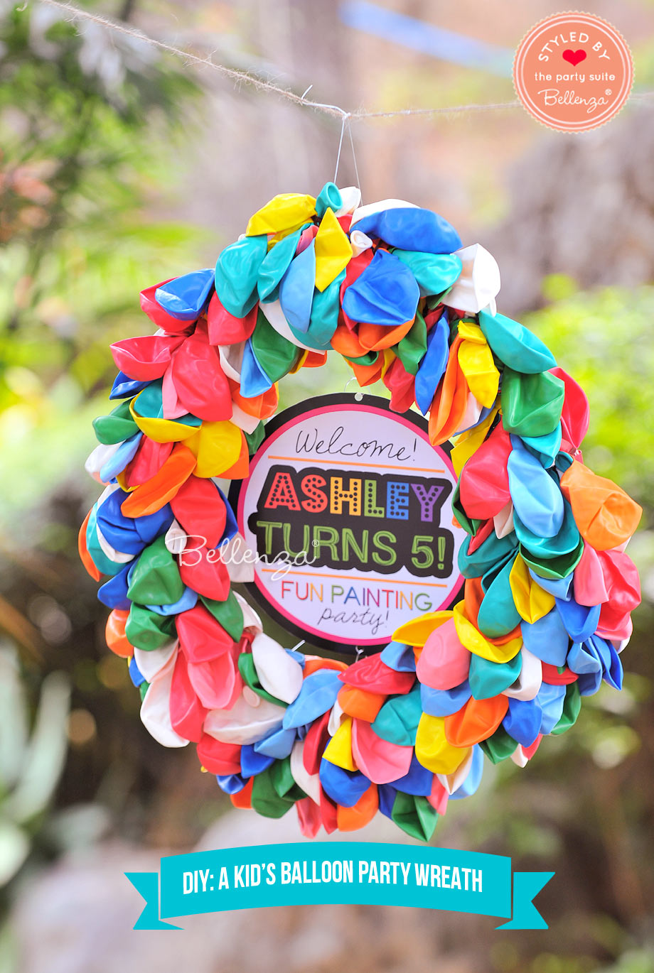 A colorful balloon wreath for an art or painting party.  It be used as a creative sign for a birthday.