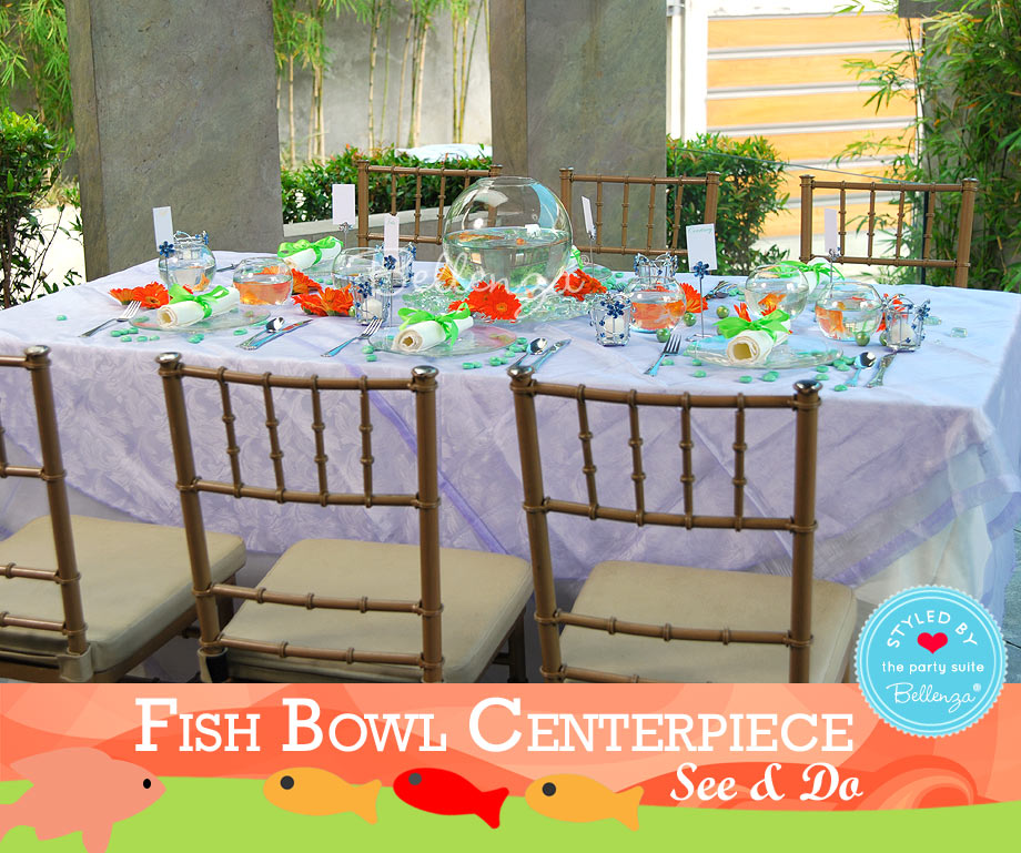 Create a tablescape with a blue, green, and orange palette of hues.