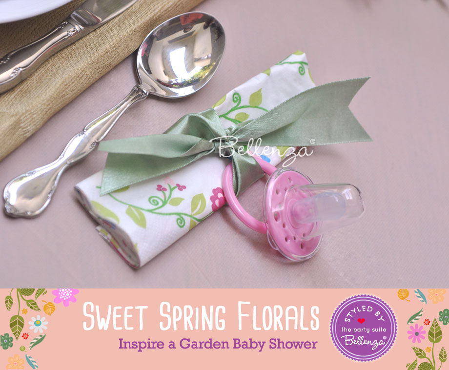 Baby pacifiers and spoon on napkin setting for spring garden baby shower | styled by Bellenza