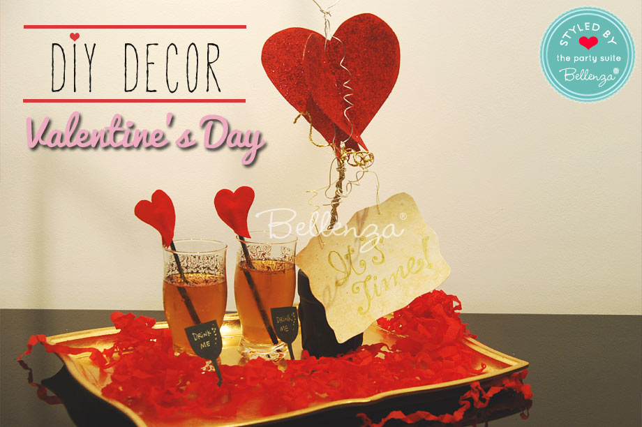 Valentine's day drinks to serve on a gold tray with heart stirrers