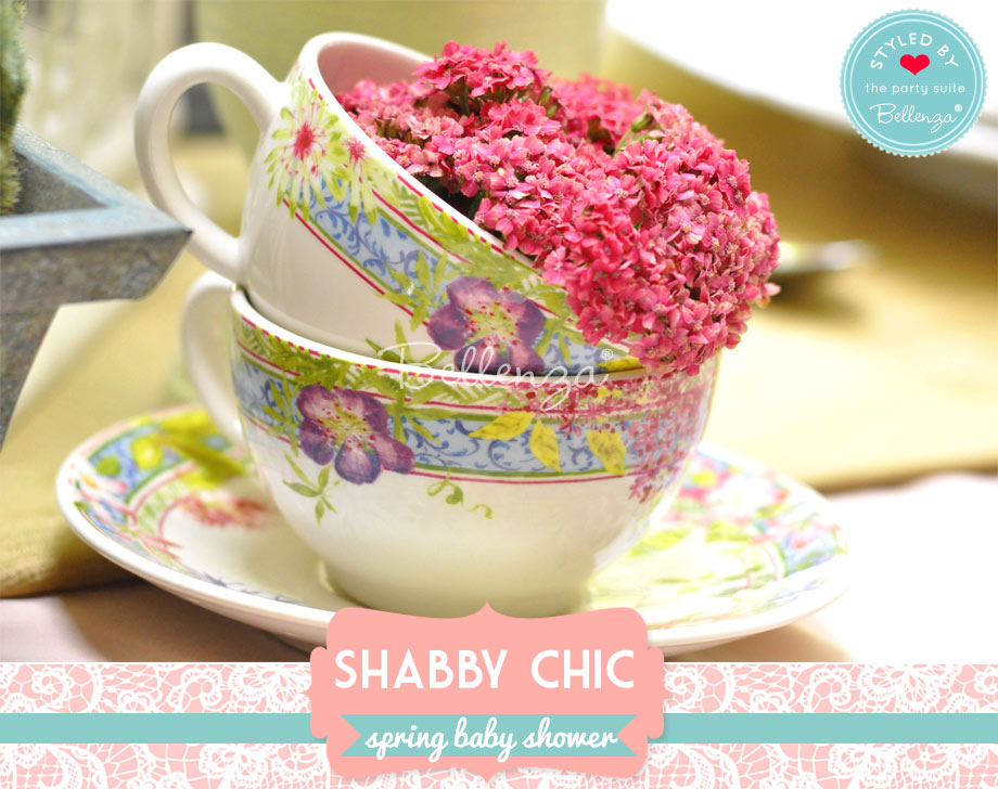 pink flowers in floral ceramic cups