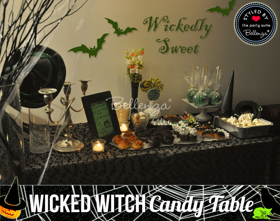 Wickedly sweet candy and snacks table with witch hats and spooky treats