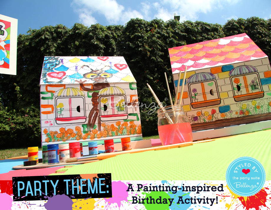 Painting cardboard houses with assorted paints