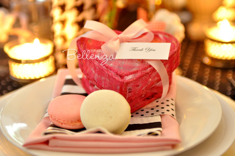 "#8 Macarons in woven heart boxes with pink ribbons and ""thank you"" tags. See the boxes at Bellenza."