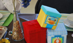 Gift box centerpieces for Mad Hatter baby shower. Photo by 3D Memoirs