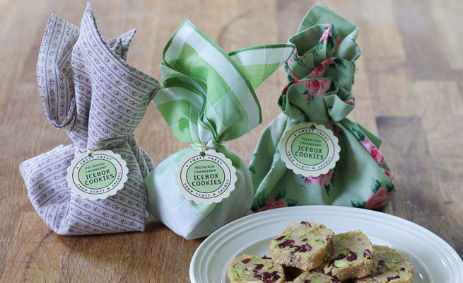 #2 Pistachio cranberry icebox cookies wrapped in vintage fabrics and napkins in various designs with scalloped hang tag in lime and gold via Evermine.