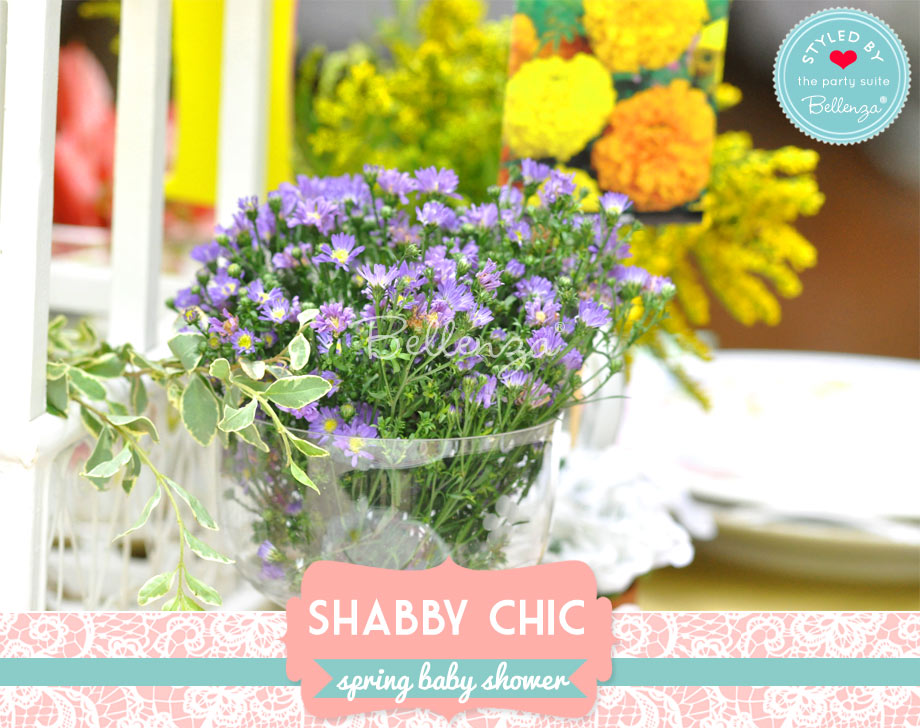 purple wild flowers in clear cups and vases