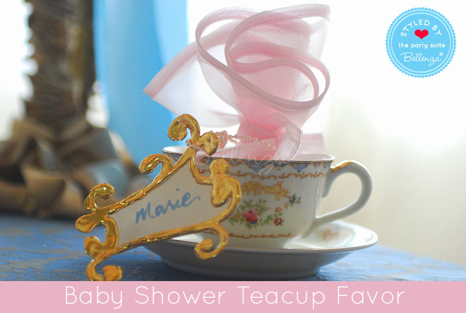Vintage teacup with golden favor tag and pink favor wrap.