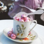 Vintage tea cups with candies.