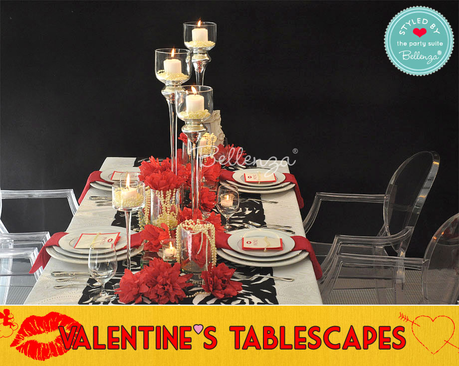 Vintage black and red tablescape with roses and damask tablecloth
