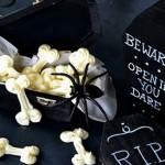 White chocolate bones in a black mini coffin