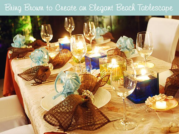 Rich brown and blue are coordinated beautifully in a sophisticated beach party table setting.