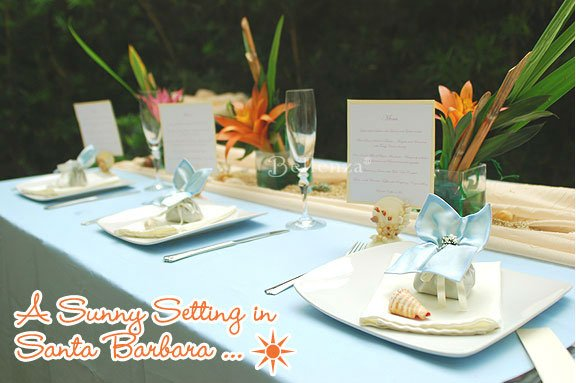 Sea blue and hints of orange in a beach-inspired tablesetting. Blue sachets atop place settings are for favors and holdign escort cards.