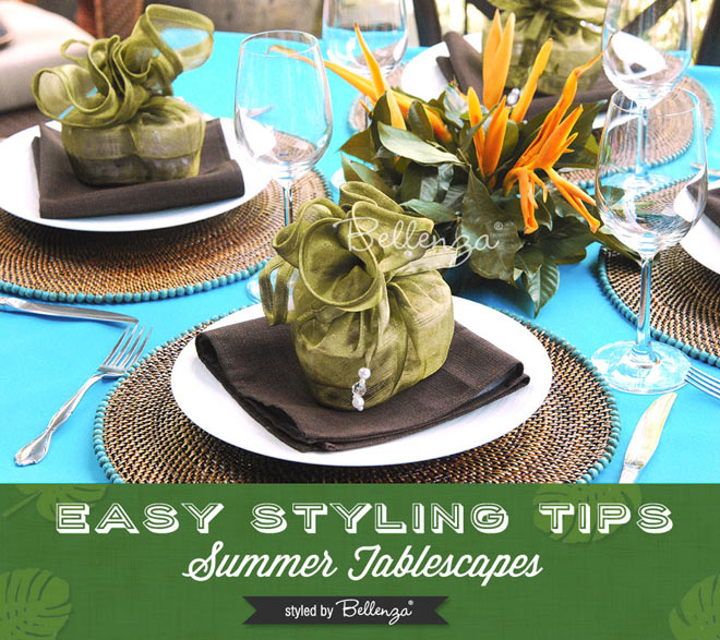 Tropical leaves, aqua, jungle green, and brown tablesetting for a beach party dinner.