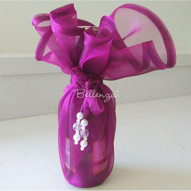 Fuchsia organza wine bottle wrap.