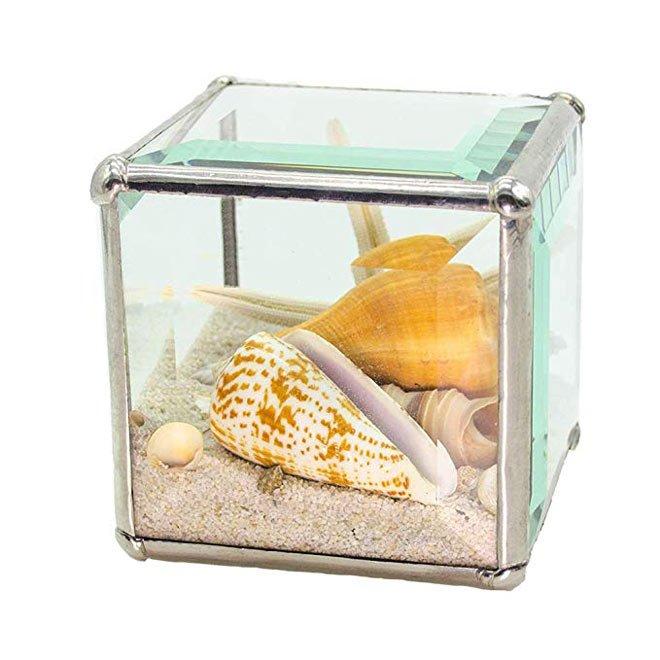 Sand and seashell hand globe