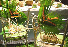 Decorating chairs with tropical leaves
