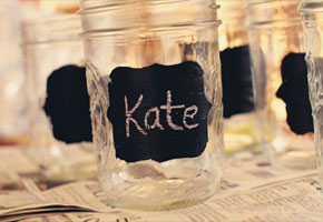 Chalkboard mason jars at wedding