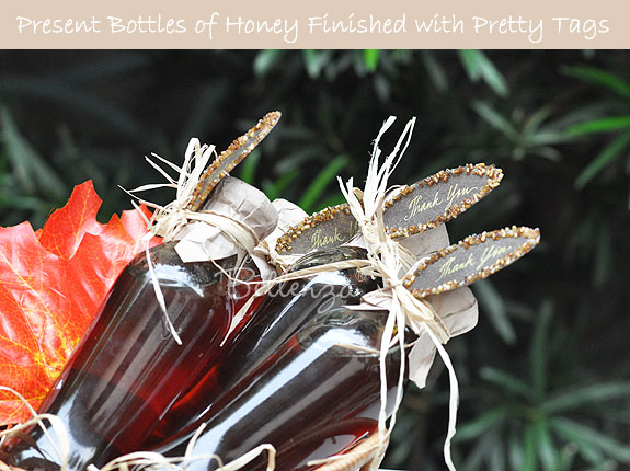Honey favors in bottles with tags