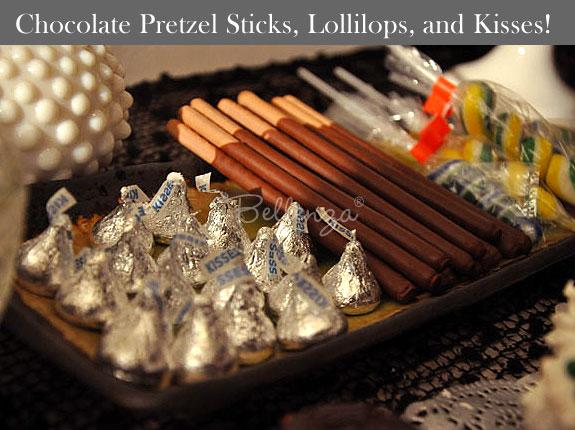 Chocolate pretzels, kisses, lollipop sticks