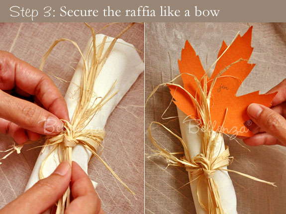 Creating  a pretty bow around the napkin ring