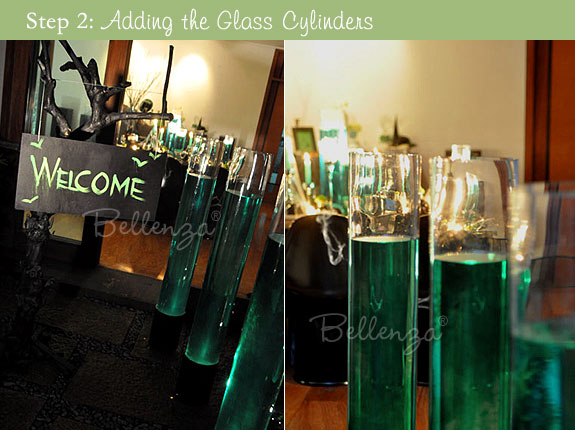 Fill tall glass vases with colored water in green