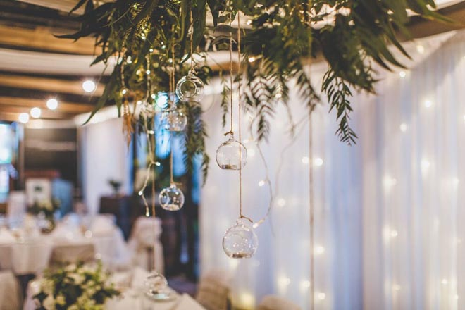 Image provided by Bwedding Invitations. Nathan and Cassie's farm nuptials. Reception decor using glass orb ornaments.