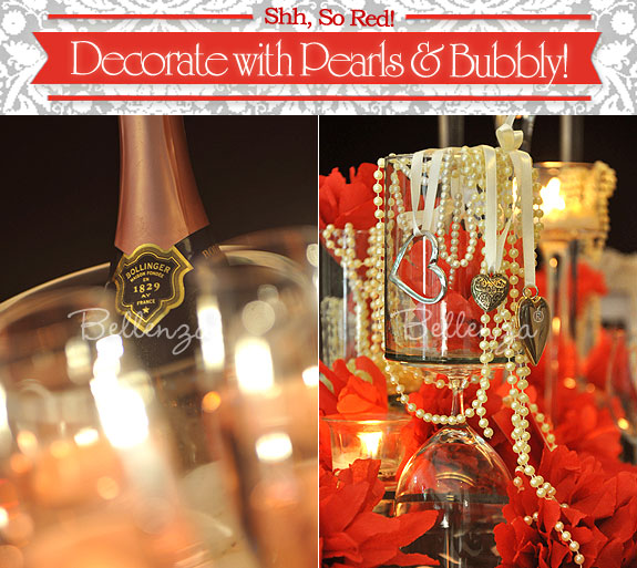 Pearl accents and champagne bottle on table.