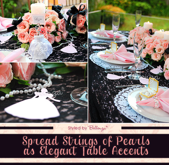 Modern vintage table decorations with pearls, black lace tablecloth, and pink rose centerpieces