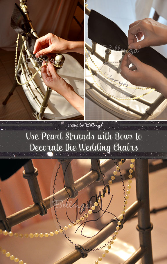 Pearl chair decorations with black ribbon bow.
