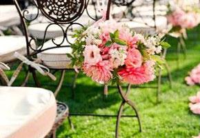Garden wedding chair decor with pink flowers