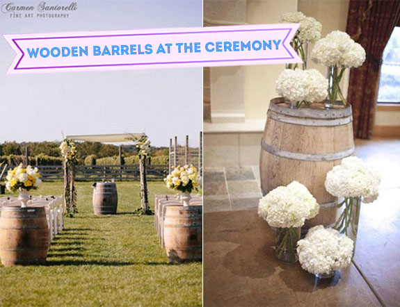Wooden barrels at an outdoor wedding with a vineyard look