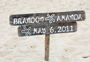Wooden sign for beach wedding