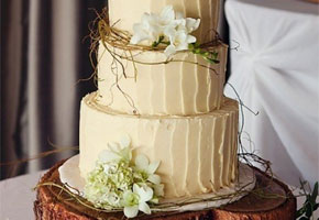 Woodland wedding cake in ivory with a wooden stump cake stand