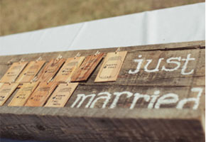 Wood escort cards via Brides.com